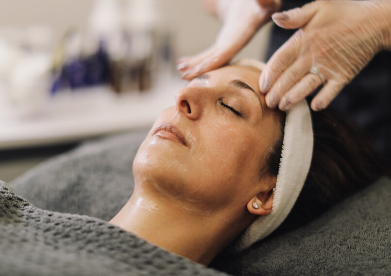 Lady receiving an iS Clinical facial